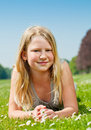 Teenager girl lying on grass Royalty Free Stock Photos