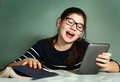 Teenager girl in myopia glasses play online game