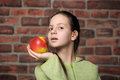 The teenager girl with a red apple Stock Photos