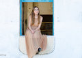 Teenager girl sit on old retro blue window in beautiful dress Royalty Free Stock Photo