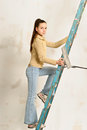 The teenager girl  on a step-ladder Royalty Free Stock Photo