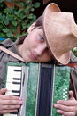 Teenager with hat accordion player outdoors Royalty Free Stock Photo