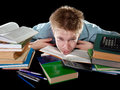 The teenager with a heap of textbooks was tired of homeworks Royalty Free Stock Photo