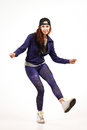 Teenager in hip hop outfit performing different dance steps Royalty Free Stock Photo