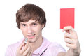 Teenager holding a red card up Royalty Free Stock Photos