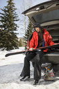 Teenager holding skis. Royalty Free Stock Images