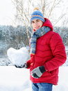 Teenager holding a snowy heart Stock Images