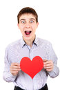Teenager holds red heart shape happy with isolated on the white background Royalty Free Stock Photo