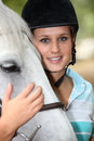 Teenager horse rider stood with Stock Images
