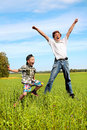 Teenager and kid jumping Stock Photography