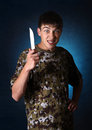 Teenager with a knife angry young man on the dark background Royalty Free Stock Image