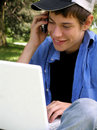 Teenager with a laptop and cellular Royalty Free Stock Photo