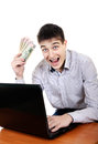 Teenager with laptop and money successful isolated on the white background Stock Image