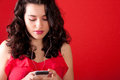 Teenager listening to music in her phone Stock Photography