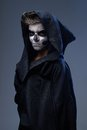 Teenager with makeup skull cape angry Royalty Free Stock Photo