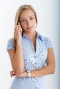 Teenager on mobile phone call portrait of smiling looking at camera Royalty Free Stock Image