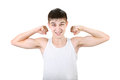 Teenager muscle flexing handsome isolated on the white background Stock Images