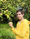 Teenager near apple tree Stock Photography