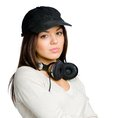 Teenager in peaked cap with earphones black wearing isolated on white Royalty Free Stock Images