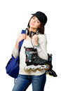 Teenager in peaked cap holding roller skates half length portrait of and wearing blue rucksack and earphones isolated on white Royalty Free Stock Images