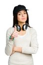 Teenager in peaked cap thumbs up black wearing earphones isolated on white Stock Photography