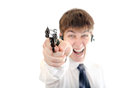 Teenager with a pistol angry on the white background Stock Photography