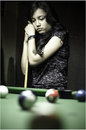 Teenager play billiard young asian woman playing Stock Photos