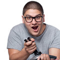 Teenager playing video games a fun loving gamer with a wireless joystick over a white background Stock Photography