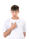 Teenager pointing at himself irresolute young man with a finger isolated on the white background Royalty Free Stock Photos