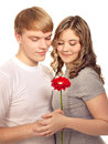 Teenager preset his girlfriend flower. Valentine day. Stock Photos