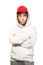 Teenager in a red cap and sportswear isolated Stock Photo