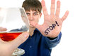 Teenager refuses alcohol isolated on the white background Stock Photography