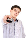 Teenager with remote control displeased on the white background Royalty Free Stock Image