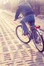 Teenager riding bike on street boy retro toned Royalty Free Stock Photography