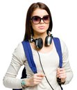 Teenager with rucksack and headphones wearing black sunglasses isolated on white Stock Photography