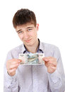 Teenager with russian bank note dissatisfied isolated on the white background Stock Photography