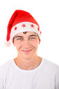 Teenager in santas hat portrait of handsome santa s isolated on the white background Royalty Free Stock Images