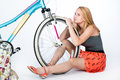 Teenager schoolgirl with her bicycle Royalty Free Stock Photo
