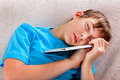 Teenager sleep with a Tablet