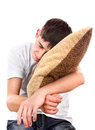 Teenager sleeps with cushion isolated on the white background Stock Photo