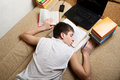 Teenager sleeps after learning on the sofa at the home Royalty Free Stock Image