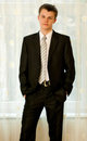 Teenager in smart black suit Royalty Free Stock Photography