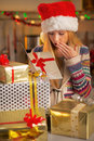Teenager with stack of christmas present boxes Royalty Free Stock Photo