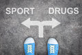 Teenager standing at the crossroad - sport or drugs Royalty Free Stock Photo