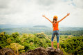 Teenager  standing on a mountain top Royalty Free Stock Photo