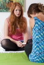 Teenager tell her friend about pregnancy teenage girl best Royalty Free Stock Images