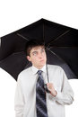 Teenager with umbrella annoyed young man isolated on the white background Royalty Free Stock Photos
