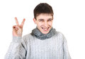Teenager with victory gesture cheerful isolated on the white background Stock Image