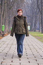 Teenager walking in a park Stock Image