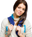 Teenager wearing blue rucksack and colored scarf isolated on white Royalty Free Stock Photo
